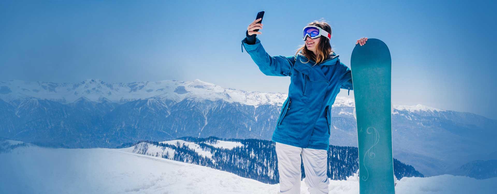 Home-banner_young-woman-snowbaord-mobile_desktop_1919x750