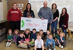 playschool staff and kids accept cheque
